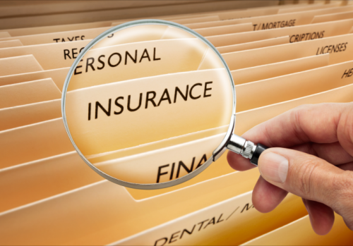 magnifying glass showing insurance text